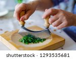 a woman shreds parsley on a...   Shutterstock . vector #1293535681
