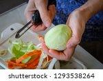 woman hand peel the fresh green ...   Shutterstock . vector #1293538264
