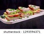 sandwiches assortment on a... | Shutterstock . vector #1293596371