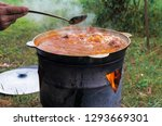 tourist iron pot with shurpa... | Shutterstock . vector #1293669301