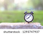 clock on stone table in the... | Shutterstock . vector #1293747937
