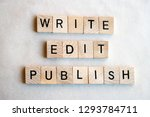 Small photo of The words Write Edit Publish written in black letters on wooden blocks, flat lay. Business and education concepts
