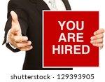 a businessman offering a... | Shutterstock . vector #129393905