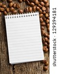 the spiral notebook and coffee beans - stock photo