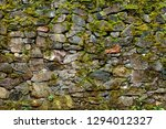 Stony Wall Overgrown With...