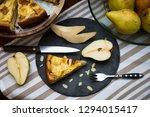 top view of piece of pear pie...   Shutterstock . vector #1294015417