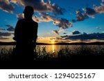 silhouette of a man in front of ... | Shutterstock . vector #1294025167