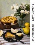 piece of pear pie with vanilla...   Shutterstock . vector #1294029541