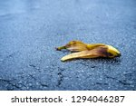 Small photo of Slapstick slippery comedy banana peel laying on ground ready to make someone slip and fall