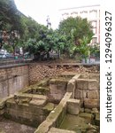 Small photo of Naples, Italy - 04 Nov 2017: Mura Greche - area where are preserved remains of the original Greek wall from 4th century BC. It was built with the typical big blocks of stone that the Greeks used.