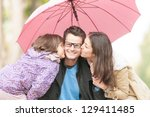 young family of three having... | Shutterstock . vector #129411485