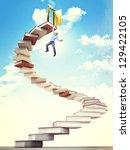 man hang on 3d book stair | Shutterstock . vector #129422105