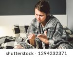 a young caucasian woman sits on ... | Shutterstock . vector #1294232371