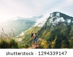 the couple greets the sunrise... | Shutterstock . vector #1294339147