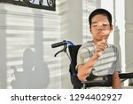 child on wheelchair is enjoy... | Shutterstock . vector #1294402927
