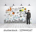 businessman drawing business... | Shutterstock . vector #129444167