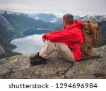 backpack man tourist in the red ... | Shutterstock . vector #1294696984