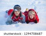 two smiling boys in winter... | Shutterstock . vector #1294708687