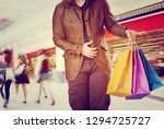 man with shopping bags in the... | Shutterstock . vector #1294725727