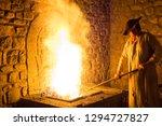 blacksmith forging in the... | Shutterstock . vector #1294727827