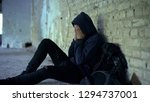 miserable teenager crying in... | Shutterstock . vector #1294737001