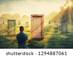 rear view man in front of many... | Shutterstock . vector #1294887061