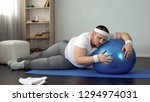 tired unmotivated obese man... | Shutterstock . vector #1294974031