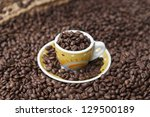 brown roasted coffee beans and... | Shutterstock . vector #129500189