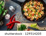 Freshly fried shrimps with herbs - stock photo