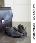 man's shoes and bag on wooden... | Shutterstock . vector #1295224591