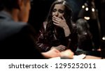 crying woman smoking cigarette... | Shutterstock . vector #1295252011
