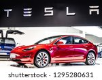Small photo of Brussels, Belgium, Jan 18, 2019: metallic red Tesla Model 3 and blue Tesla model X at Brussels Motor Show, produced by American automaker Tesla, main shareholder Elon Musk