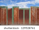 Zinc Fence On Blue Sky...