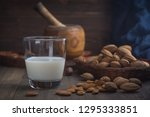 almond milk in glass with... | Shutterstock . vector #1295333851