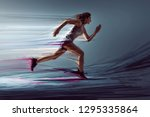 runner woman with paint effects | Shutterstock . vector #1295335864