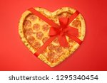 pizza shaped heart with red bow ... | Shutterstock . vector #1295340454