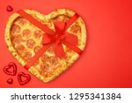 pizza shaped heart with red bow ... | Shutterstock . vector #1295341384