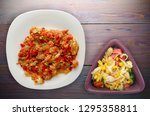 stewed tomatoes with onions in... | Shutterstock . vector #1295358811