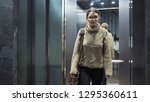 young woman in the elevator   Shutterstock . vector #1295360611