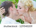 happy young bride and groom... | Shutterstock . vector #129540209