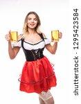 young oktoberfest woman wearing ... | Shutterstock . vector #1295423584