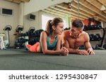 young fit happy couple doing... | Shutterstock . vector #1295430847