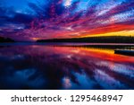 the stunning sunsets over clear ... | Shutterstock . vector #1295468947