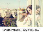 teenage girl looking out the... | Shutterstock . vector #1295488567