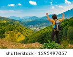 young mountain hiker with arms... | Shutterstock . vector #1295497057