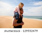 father carrying young daughter... | Shutterstock . vector #129552479
