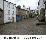 cobble street in a village   Shutterstock . vector #1295595277