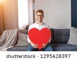 handsome man in stylish glasses ...   Shutterstock . vector #1295628397