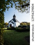 the graveyard and its chapel is ...   Shutterstock . vector #1295629804