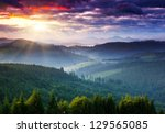 Stock photo majestic mountains landscape under morning sky with clouds overcast sky before storm carpathian 129565085